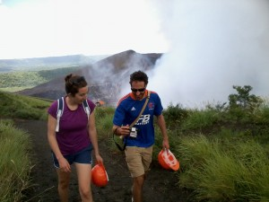 Two guests hike past the crater of a volcano in Nicaragua.