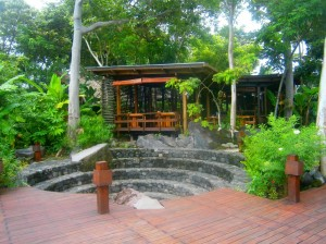 The green foliage surrounds Jicaro Island Ecolodge.