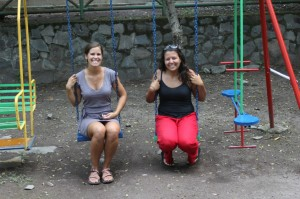 Jen and Soraya sitting in the swings of the new playground Jicaro helped to install.