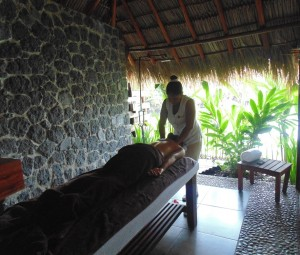 Getting a massage in Jicaro's open air spa rooms