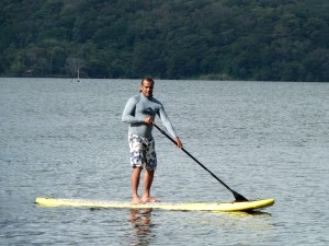 A guest going for a standing paddle board on Lake Nicaragua